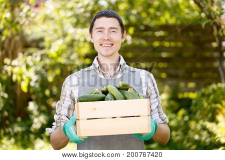Photo of brunet with cucumbers