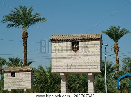 EGYPT, January 15, 2005: Armed guards in stone boxes on tall poles, Egypt, North Africa, Africa