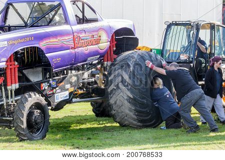 Monster Truck Slingshot Wheel Being Put On