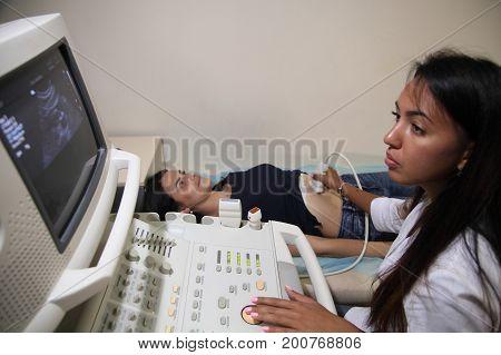 VINNITSA, UKRAINE, JULY 27, 2017: Ultrasonic examination of internal organs in a young girl.