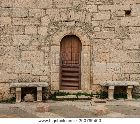 Old door steone wall and stone bench Croatia HR