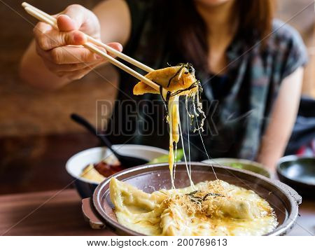 Gyoza With Melt Cheese Took By Chopsticks