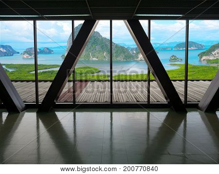 View from building window of landscape mangrove forest mountain and sea with blue sky white cloud. Travel concept.