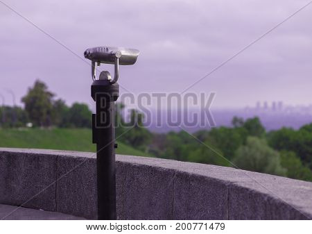 Spy viewing coin machine on nature background