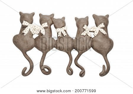Statuette of clay cats group turned backwards isolated on white background
