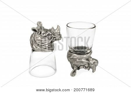 Two empty glasses for the vodka to the bottom in the form of an inverted rhinoceros isolated on white background