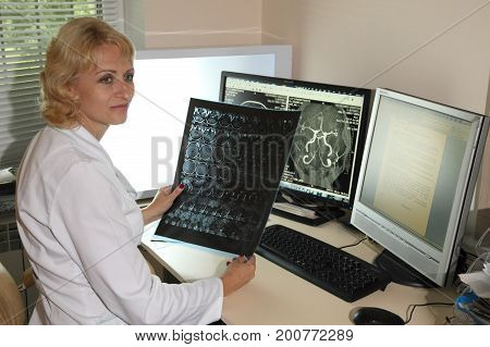 VINNITSA, UKRAINE, JULY 27, 2017: omputed tomography lab. Computerized Axial Tomography (CAT). Young woman having an magnetic resonance imaging.