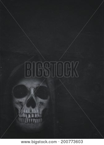 Human Skull In Hood On Dark Background. Halloween Banner