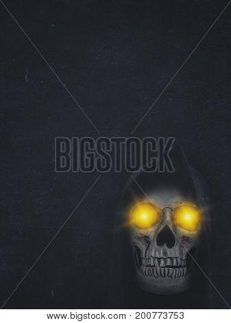 Human Skull In Hood With Burning Eyes On Dark Background. Halloween Banner