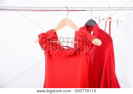 female red dress ,pants on hanger