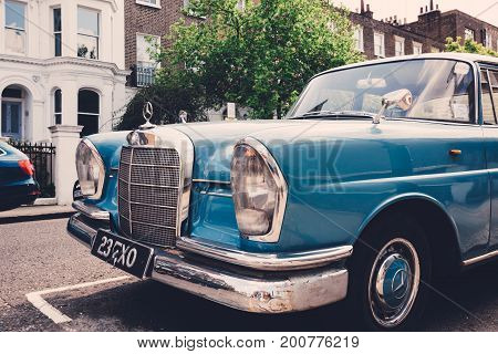 LONDON, UK - MAY 17, 2016: Old blue Mercedes-Benz 600 parked on a side of a road in London on a sunny day. The Mercedes-Benz 600 was produced from 1963 to 1981.