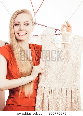 Woman In Shop Or Wardrobe Picking Dress