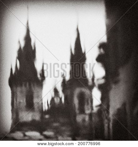 Prague, Czech Republic: a reflection in a puddle of the Cathedral. An artistic image. Black and white photo. Water, towers, domes, vague. The image of a Cathedral.
