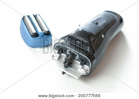 Electric shaver on a white background close up