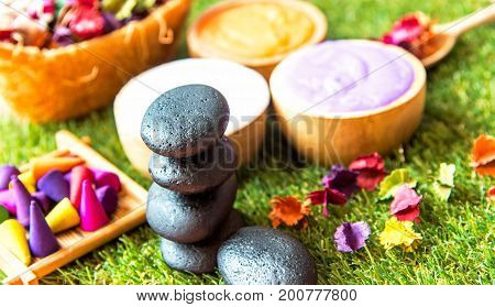 Spa Thai setting for aroma therapy and sugar and salt massage rock spa with flower on the bed relax and healthy care. Healthy Concept