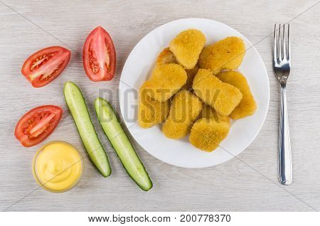Chicken Nuggets In Plate, Vegetables, Bowl With Mayonnaise And Fork