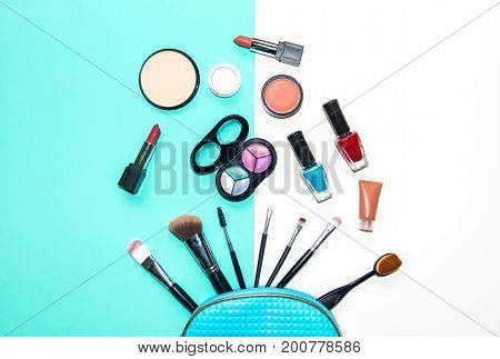 Cosmetics and fashion background with make up artist objects: lipstick eye shadows mascara eyeliner concealer nail polish. bule and white background. Lifestyle Concept