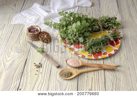 Dry and fresh herbs spices on a wooden table close-up