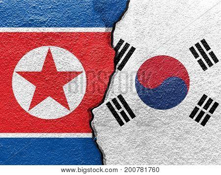 South Korea and North Korea's flag on cracked wall