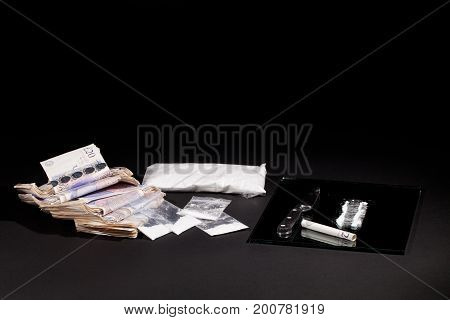 Drug dealing. Cocaine drugs haul with UK money and a line of coke. Bags of cocaine and heroin.