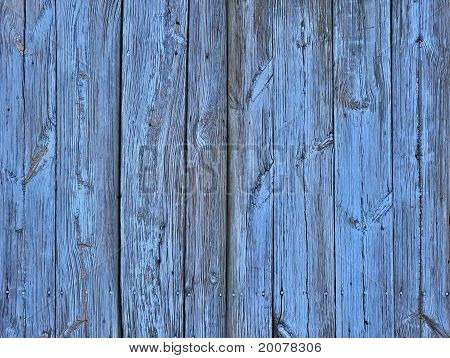 Old wooden background with vertical boards painted in blue