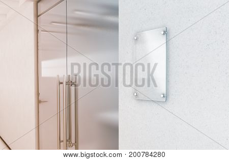 Blank vertical transparent glass sign plate mock up 3d rendering. Nameplate mockup on the wall near office entrance interior. Signage panel store door template. Clear printing framework for branding