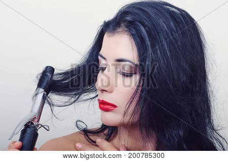 a girl with the rectifier of hair