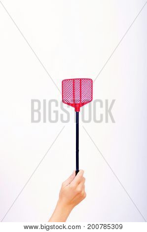Red fly swatter in a woman's hand