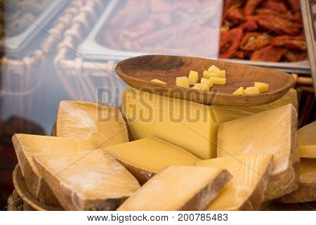 Chunks of different cheeses at a local european market. Horizontal shot with selective focus