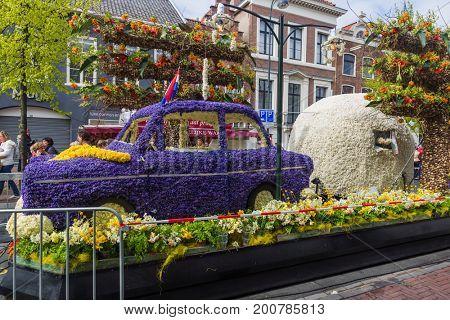 HAARLEM NETHERLANDS - APRIL 23, 2017: Statue made of tulips at flowers parade on April 23, 2017 in Haarlem Netherlands.