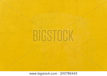 A bright yellow dry wall texture as a background