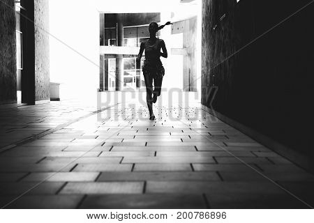Young Woman Running On The Street