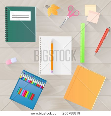 Back to school. A set of stationery with a long shadow. Desktop top view