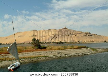 The river is the Blue Nile, Elephantine island and the fishing felucca. Aswan, Egypt, North Africa, Africa