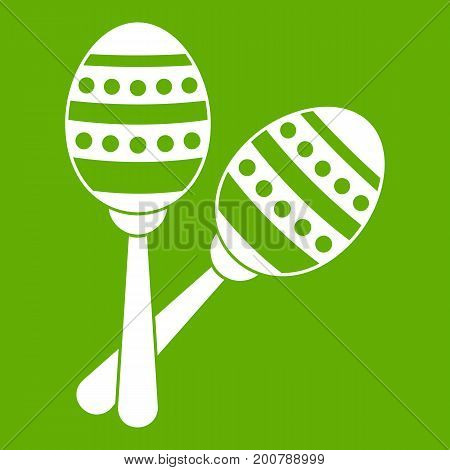 Maracas icon white isolated on green background. Vector illustration