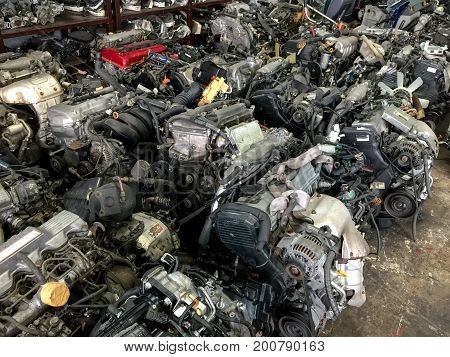 Old machine parts in second hand machinery shop ,used vehicle spare parts, second hand, for sale in garage