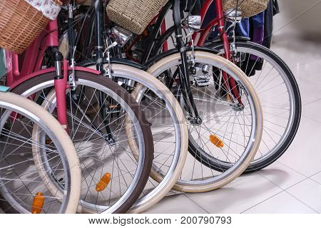 Row of new modern bicycles in shop