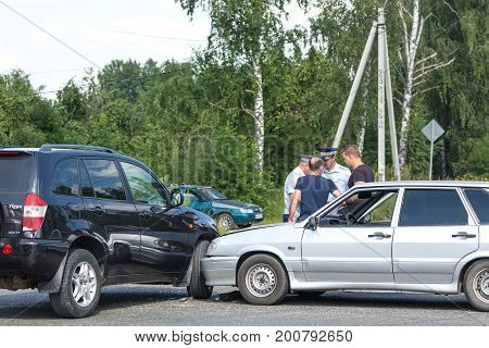 MOSCOW RUSSIA - AUGUST 2017: Car automobile crash from car accident on the road in a city with police and crash participants