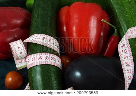 Different fresh vegetables with tape measure on them