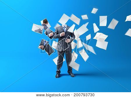 Printing A businessman. A person being made/ lost in printed paper blowing in the wind. business concept.