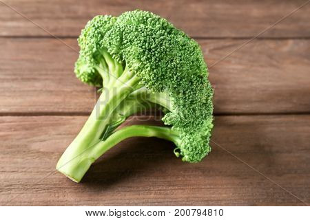Fresh green broccoli sprout on brown wooden table
