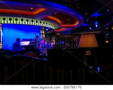 Barcelona, Spain - September 12, 2015: Musicians playing jazz at the bar at cruise liner Allure of the Seas at Barselona on September 12 2015. The second largest passenger ship constructed behind sister ship Oasis of the Seas by Royal Caribbean.