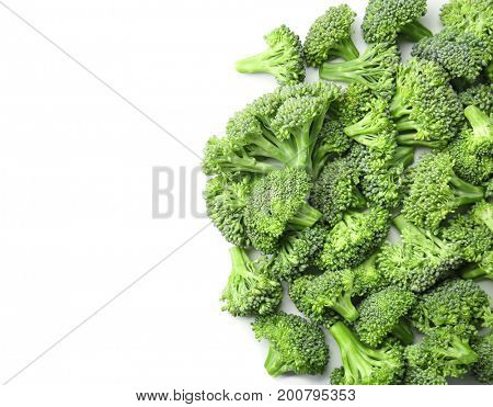 Green broccoli sprouts on white background