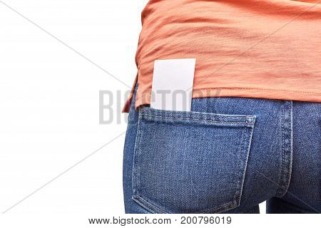 Business card in a pocket of blue jeans. Isolated on white background.