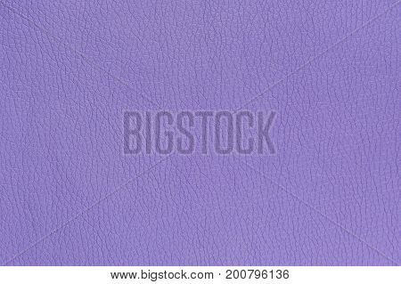 A purple artificial leather background texture close-up