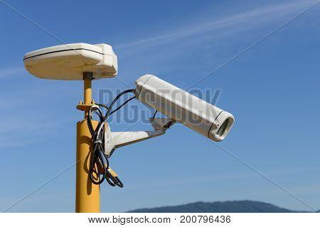 image of CCTV camera against a blue sky
