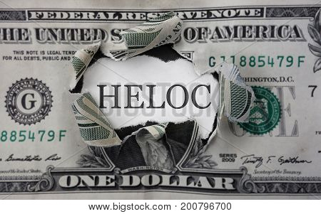 Torn dollar with HELOC ( home equity loan) text