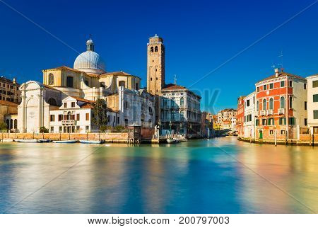 Venice Italy. Grand Canal and Venetian old architecture against the clear blue sky on the background. Long exposure photography