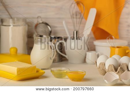 Kitchen utensils tools and products for homemade cakes on a light wooden background. Selective focus.