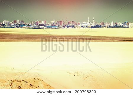 View of the city of Ismailia with light reflex in the sky from the newly opened extension canel of the Suez Canal with blazing heat